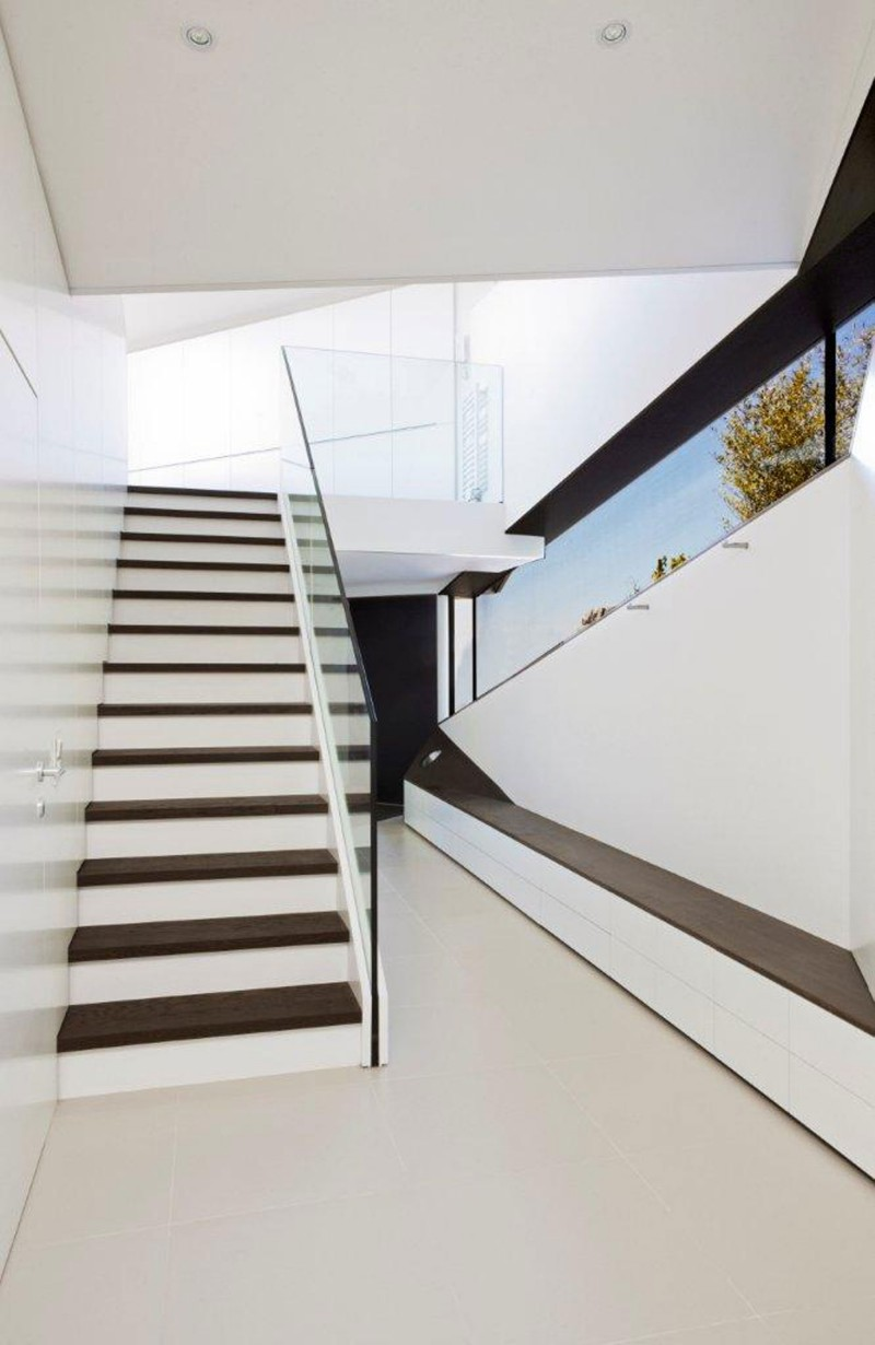Stunning Stair Design With Glass Banister And Wooden Steps