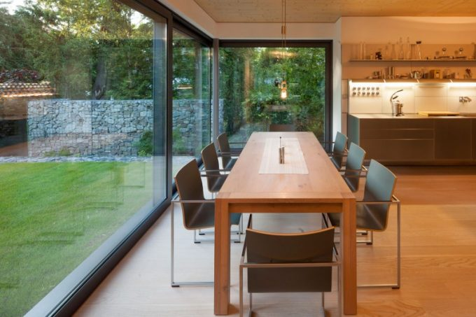 The Dining Details With Glass Wall Wooden Dining Table And Large Kitchen