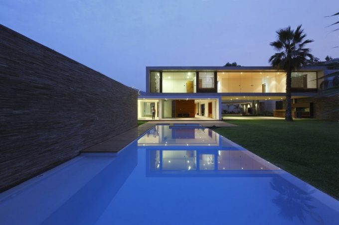 The Rear Landscape With Cool Blue Water Pool Decor And Green Grass Yard