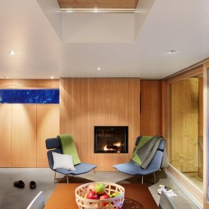 Warm Interior Decor With Lounge Chair Near The Fireplace