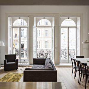 White Living Room And The Glass Window Modern Flat Designing