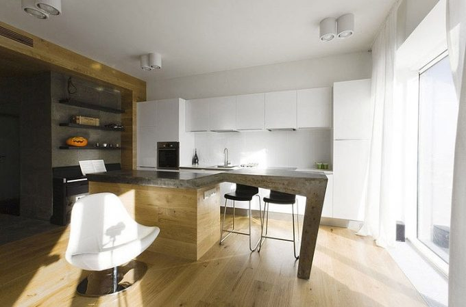 White Kitchen Countertop And Marble Kitchen Island With Unique Shape