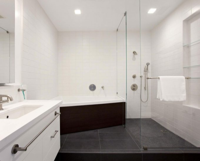 White Sink And Bathtub With Glass Partition Shower Space Design