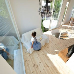 Wooden Floor Lounge Room With Large Glass Window