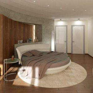 A Wooden Wall Behind The Circle Bed Brings A Different Textural Element In Soft Chocolate Theme Bedroom
