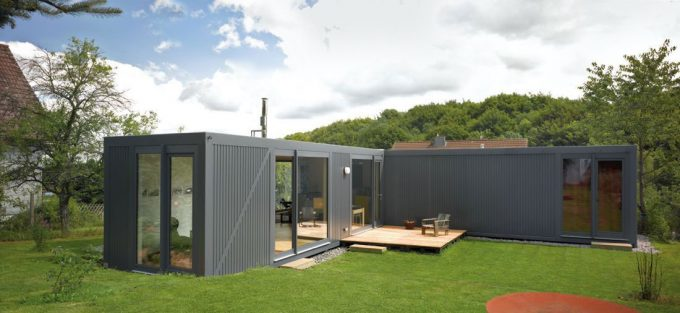 Container House With Grey Steel And Glass Design