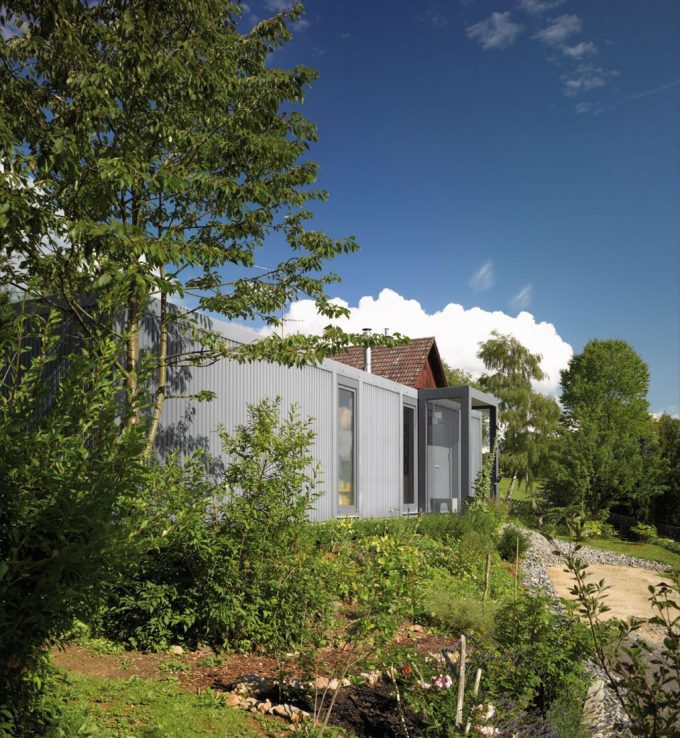 Container With Green Vegetation Surroung Inspiring Green House Design