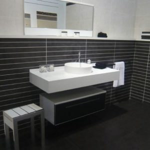 Contemporary Bathroom With Wall Sink Is Stylish Floating Sink And Under Vanity Space Saver