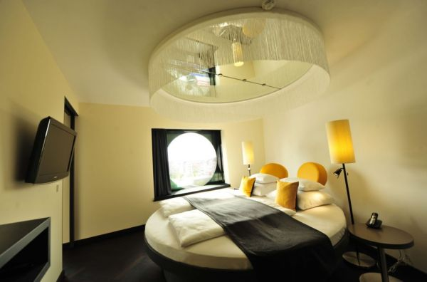 Dazzling Lighting And Yellow Accents Steal The Show Here Round Shape Bedroom Theme Design