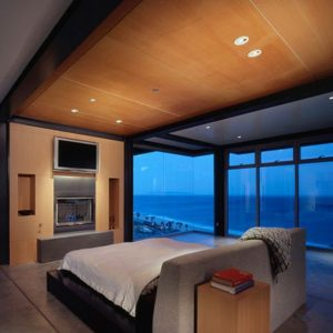 Elegant Bedroom With A Stylish Floating Bed With Black Glossy Finishing