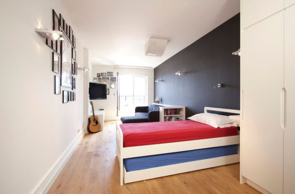 Elegant Kids Bedroom With A Trundle Bed Perfect For A Sleepover Awesome Compact Bed Design