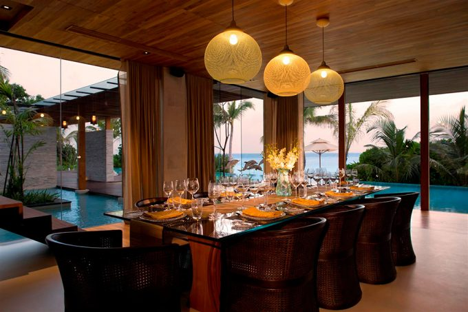 Evening View From The Dining Room With Comfortable Dining Room Decor And Floor To Ceiling Glass Window