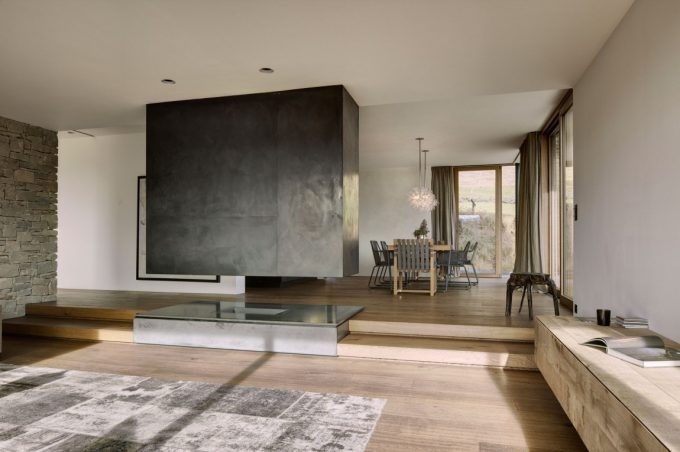 Haus Wiesenhof Charcoal Interior Monimalist Character With Wooden Floor Stone Wall Simple Furniture
