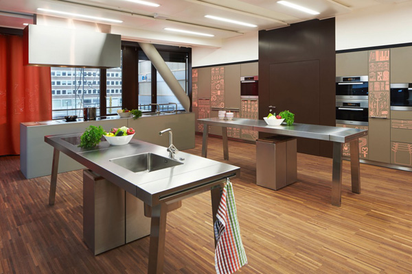 Kitchen Space With Stainless Steel Countertops And Kitchen Island Hotel Room Design