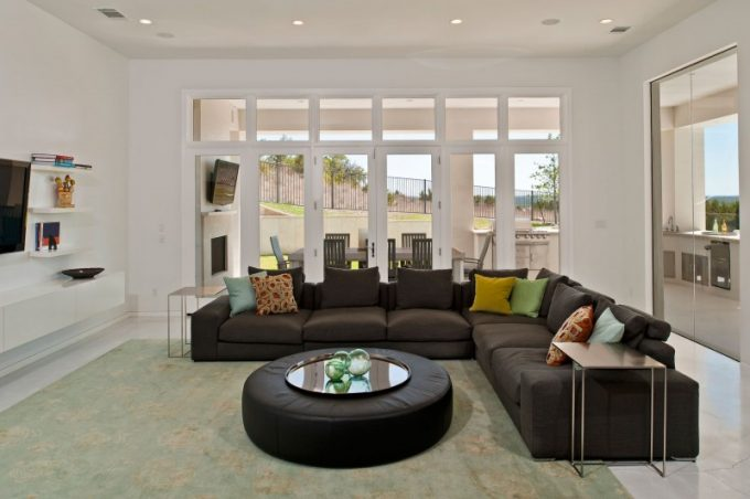 L Shape Sofa With Round Table Design And Wooden Framed Glass Window