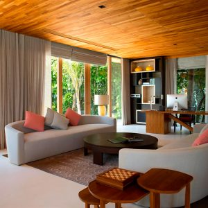 Lovely Lounge Room With Cozy Sofa Glass Window And Green View Modern Villa In Maldives