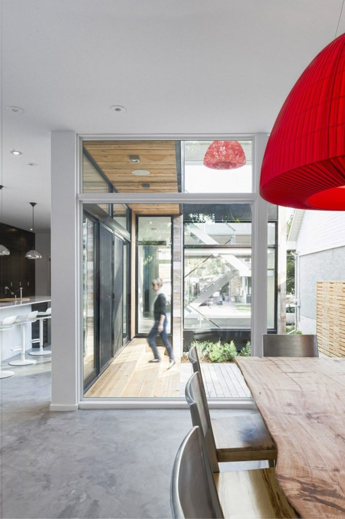 Modern With A Little Bit Of Rough In Dining Space Decor Wirh Wooden Dining Table And Red Pendant Lamp