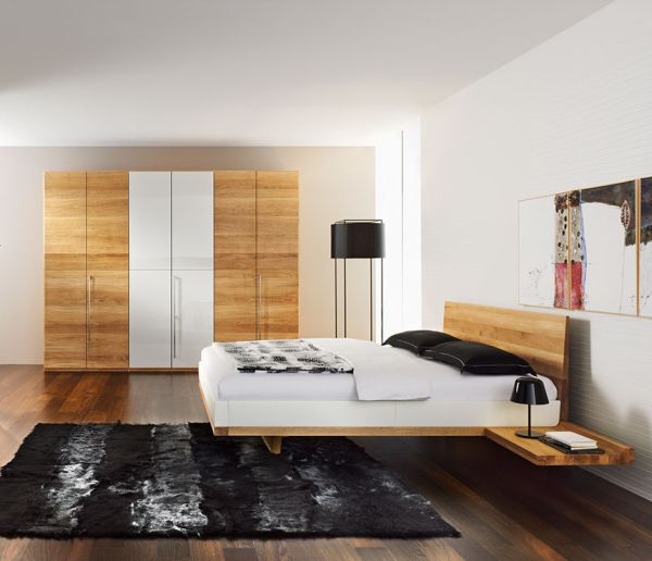 Modern Bedroom Sporting A Chic Floating Bed Design And Dark Rugs Below The Bed