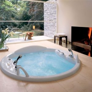 Modern Round Jacuzzi Next To A Beautiful Fireplace With Sunk Jacuzzi Design