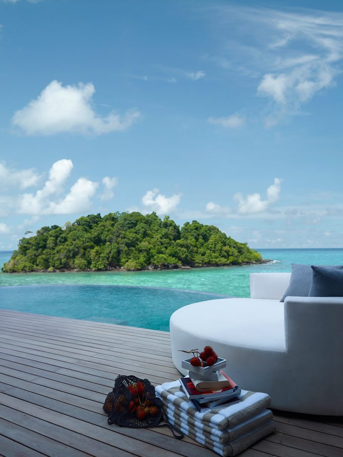 Private Island Resort Comfort White Lounge Chair With Island View And Breezy Air