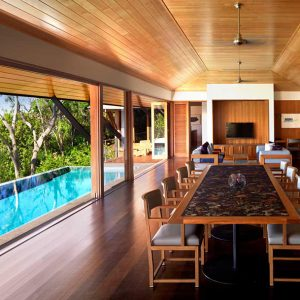Qualia Resort Dining Space With Wooden Interior Dining Theme With The Peaceful Beach View