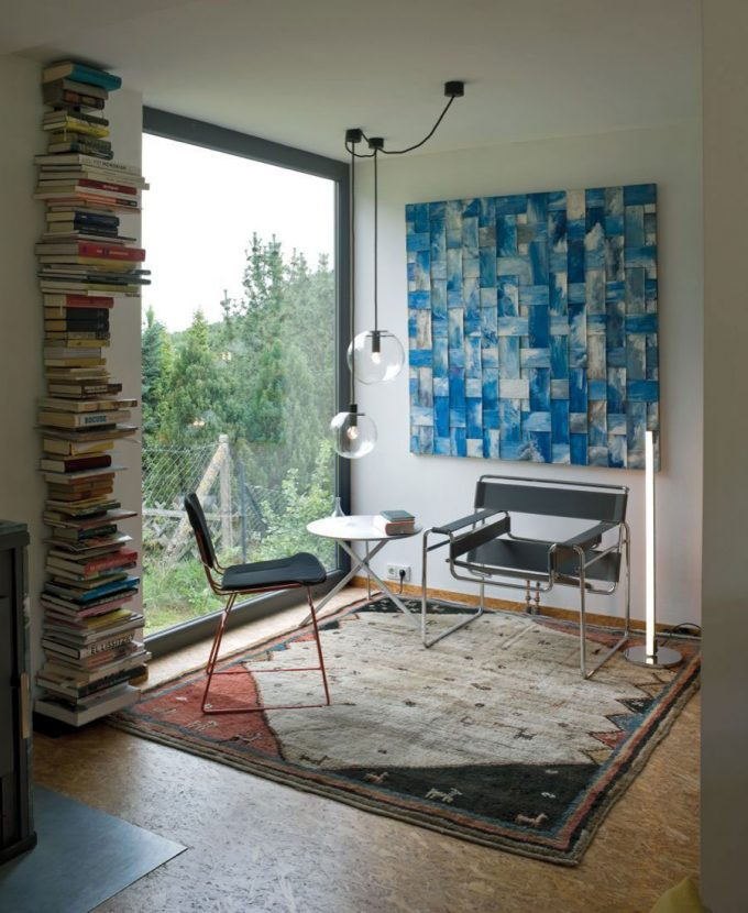 Reading Corner With Floor To Ceiling Glass Window And Simple Furniture Also Rustic Rug