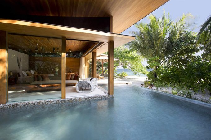 Relaxation With Breezy Openspace Lounge Room With Cool Pool And White Sand Beach Scenery