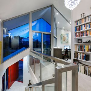 Upper Floor Metallic Details In Banister With Glass And Window Frame