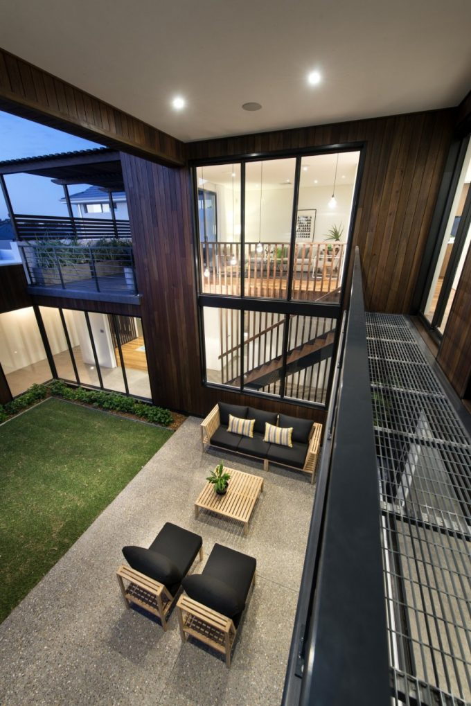 Upper View 2 Story Modern House Design With Brown Wooden Glass And Concrete Exterior Warhaus Design By  Residential Attitudes