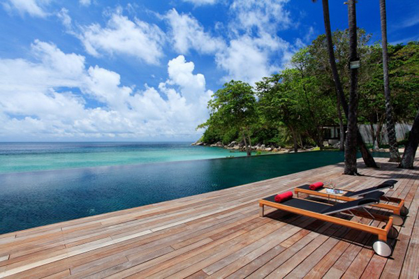 Wooden Deck Pool Side With Natural Coconut Tree And Amazing Sea View