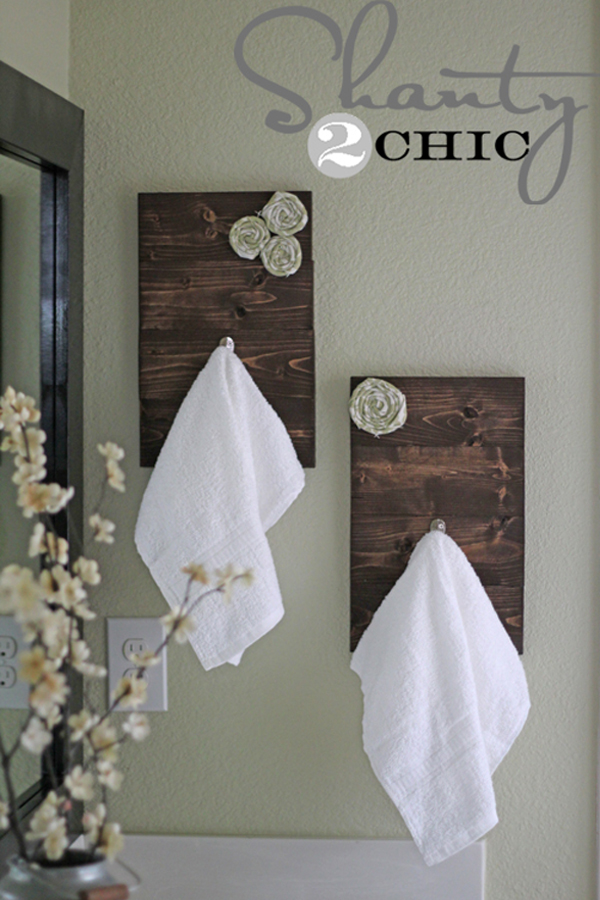 Awesome Dark Wood Towel Hooks With Fabric Rosettes And Wood Palette Platform