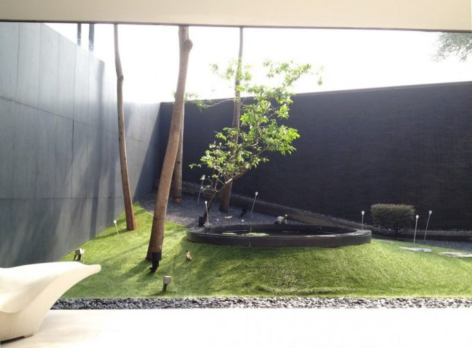 Awesome Landscaping Design With Small Pond And Green Grass