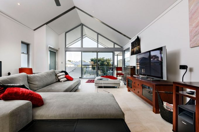 Awesome Living Space With Grey Sofa And Floor To Ceiling Glass Window