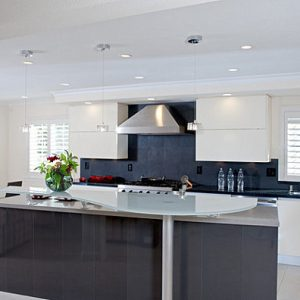 Beautiful Contemporary Kitchen With Bold Floral Arrangement And Luxury Furnishing