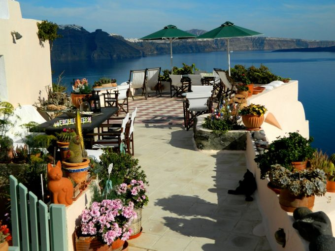 Beautiful Balcony With Flowers Decor And Rustic White Exterior Outstanding Cave Hotel In Oia