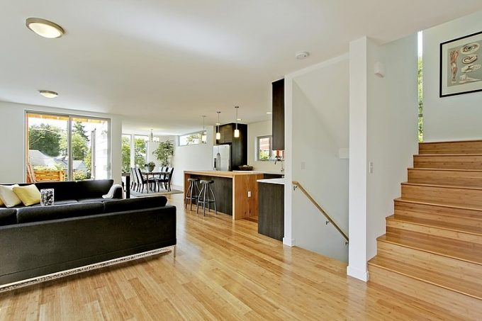 Beautiful Bright Living Space Arrangement With Wooden Floor And Wood Staircase