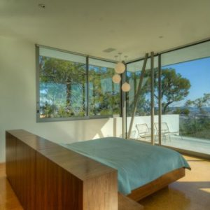 Bright Bedroom With A Floating Bed In The Center Of The Room Gives The Best Possible Views