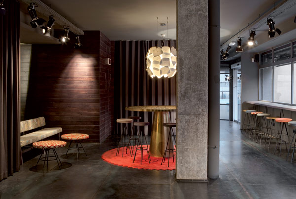 Chic And Basic Hotel Artistic Lounge Space With Warm Interior And Barstool