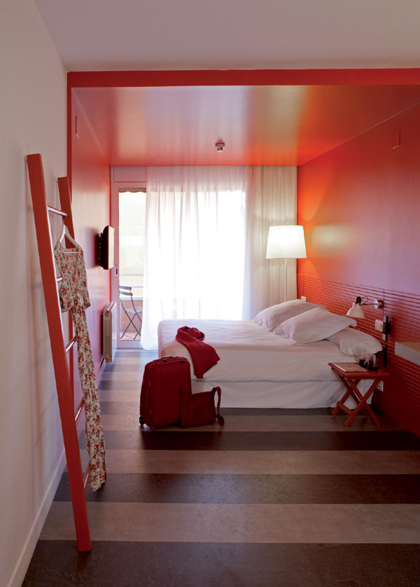 Chic And Basic Hotel Bedroom With Orange Decoration Contemporary Spanish Hotel