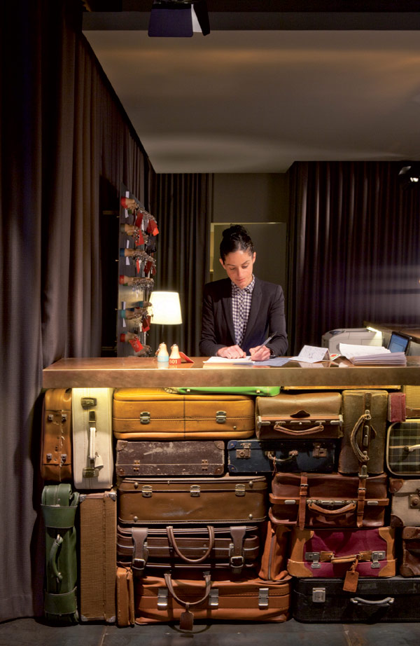 Chic And Basic Hotel Reception With Artistic Suitcase Table