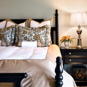Classic Bedroom With Comfy Bed Linens And Vintage Bed Design