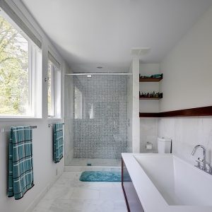 Clean And Bright Bathroom With Transparent Glass Windows And Paralel Powder Space Bathtub And Shower Space