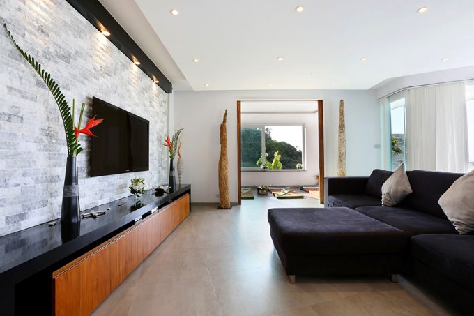 Comfortable Indoor Lounge Space Design With Cozy Black Sofa And Spacy Interior