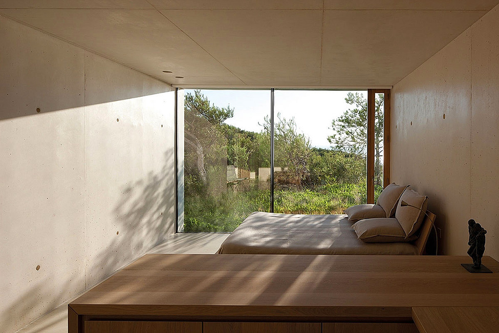Cool Bedroom Design With Concrete Wall And Floor To Ceiling Window And Wooden Furnishing
