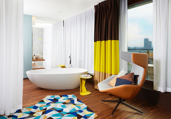 Cozy Bathroom Design With Black Yellow Curtain And Relaxing Bathtub Design