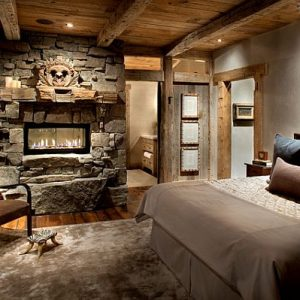Cozy Rustic Bedroom Design With Stone Fireplace And Wooden Palette Floor And Ceiling