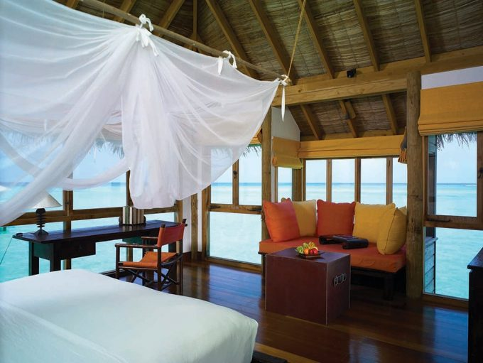 Cozy Tropical Bedroom Design With White Curtain Wooden Floor And Sea Scener