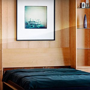 Creative Bed Decor With Artwork Behind A Murphy Bed Compact Room Design