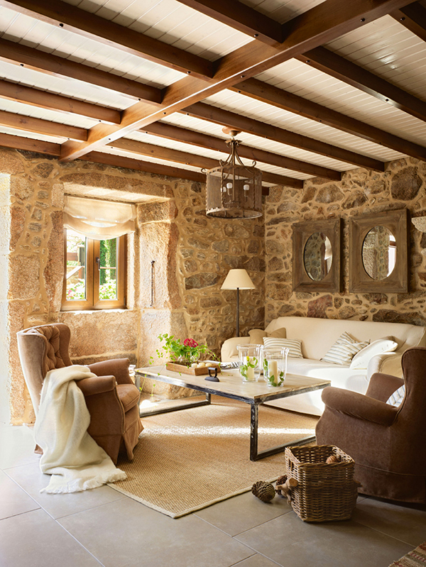 Earthy Interior Decor With Stone And Wood Interior And Comfy White Sofa Decor