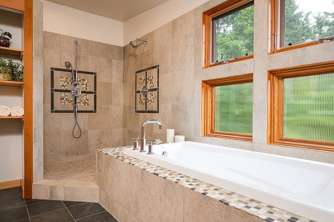 Elagant Bathroom Design With White Tub Wooden Casing Window And Tiled Wall